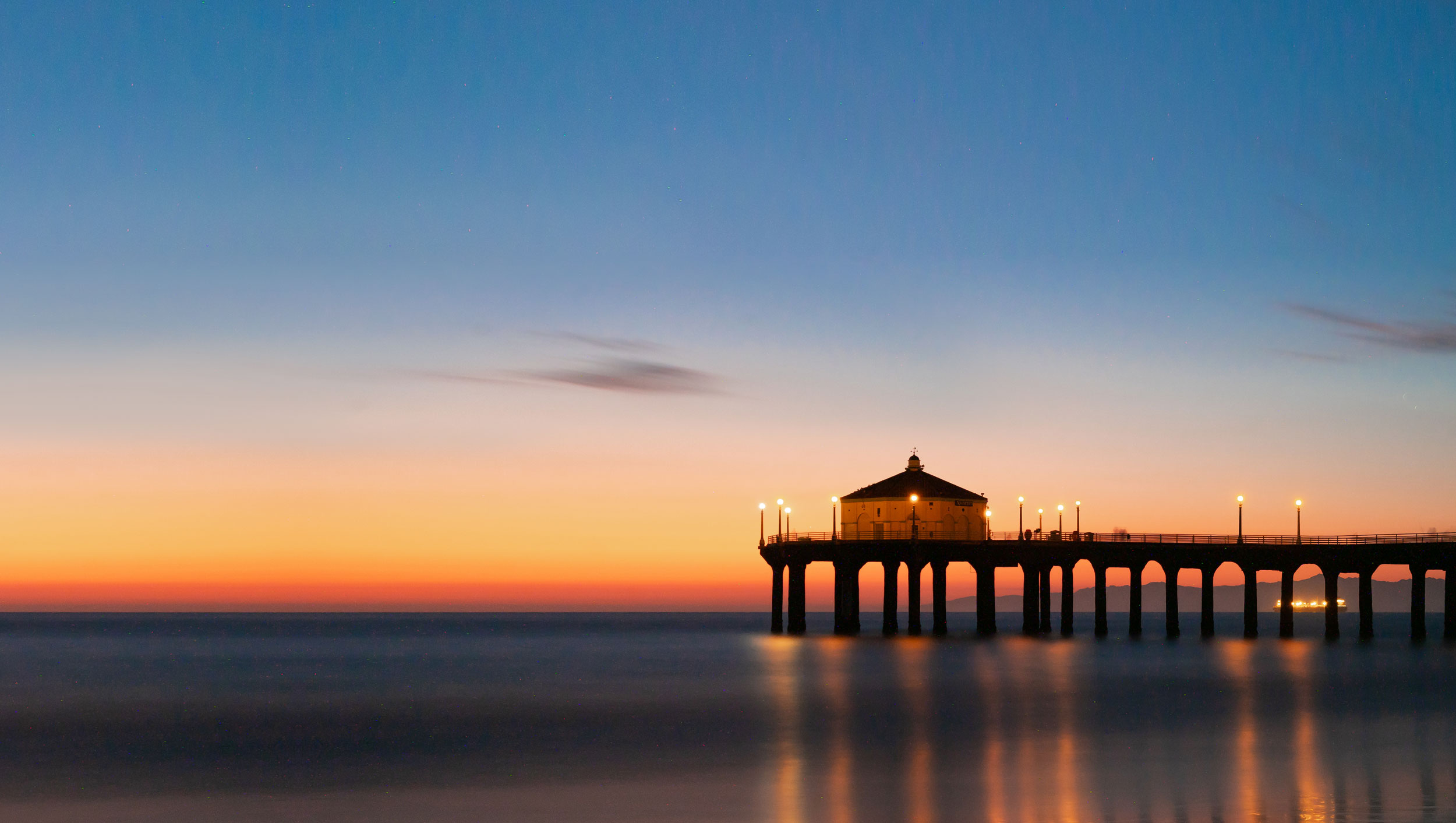 The Manhattan Beach Pier and Roundhouse at sunset.